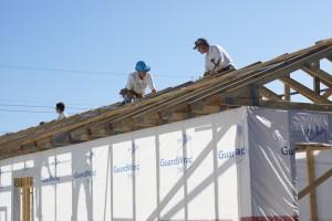 Linda L., Lynn, and Bruce, adjusting the truss peaks