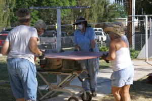 An all female crew cutting batten strips on the table saw.