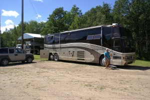 Our coach and car parked by their Bluebird next to the forest.