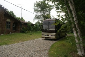 The coach in front of the house, waiting for its next trip.