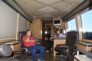 Marty explaining to Graciella who John McCann is and what it meant for his campaign to use this H3-45 executive coach as their presidential campaign tour bus.