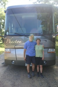Ed & Betty Burns in front of their motorhome.