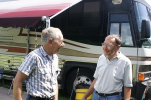 Larry (L) talking to Ed (R) in front of Ed's coach.