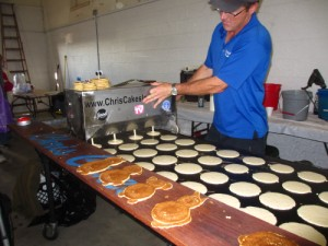 The pancake depositor at work.  That's a lot of pancakes!
