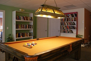 Billiards table and library.