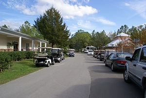 Clubhouse on the left, pool house on the right, golf carts in the middle.