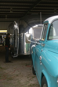 A vintage Airstream trailer and tow vehicle.