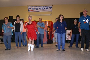 Sally Langwah leads a line dance.