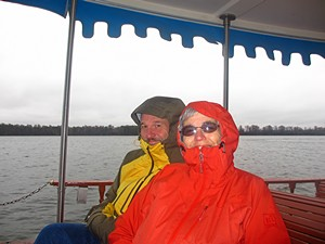 Us on one of the WDW boats bundled up against the weather.  (Photo by Vickie Lintner.)