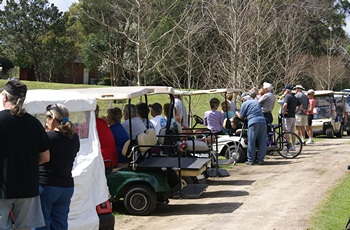 Golf Cart Rodeo spectators and waiting contestants.