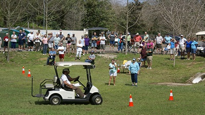 Kevn & Sharon coming in to the finish line of the golf cart rodeo course.