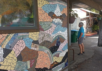Part of the tile work at Satche''s in Gainesville, FL.  Linda studying the bulletin board.