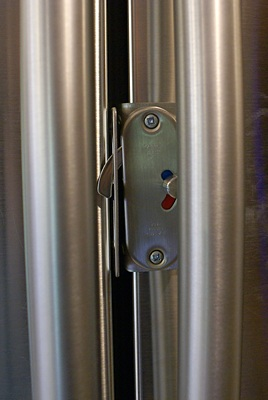 Door latch for side-by-side residential refrigerator doors.