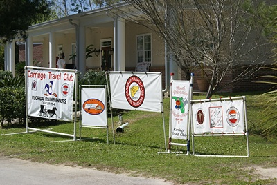 Carriage Travel Club banners.  They have ~70 rigs at WCRVR all week for a rally.