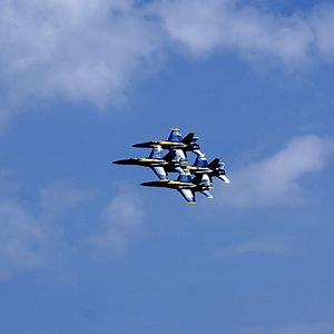 Four of the six U. S. Navy Blue Angels in diamond formation.