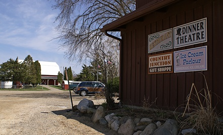 Turkeyville antique barn (rear, left) and signs for the various attractions.