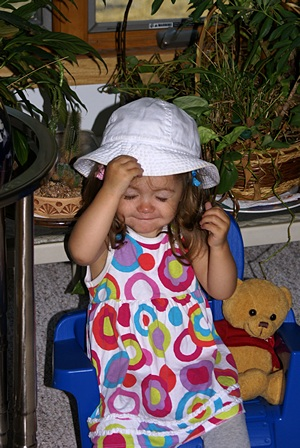Madeline likes her hat and her chair!
