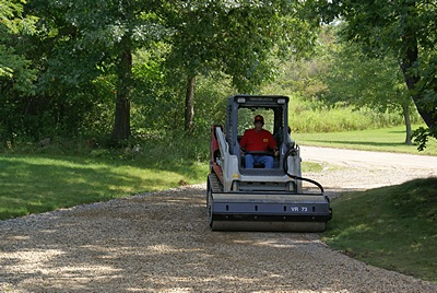 Rolling and compacting the driveway.