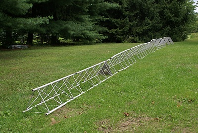 Heights Tower Systems aluminum tower sections laid out in the yard.