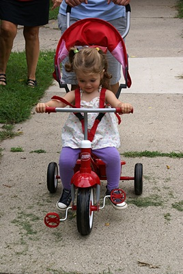 Madeline goes for a ride on her new Radio Flyer tricycle.
