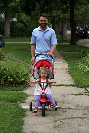 MEF3 steers the Radio Flyer with a little help from her dad.