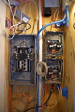 MC-9 house wiring.  Inverter panel on the left, shore/genset panels on the right.  DC upper left, solar upper right.