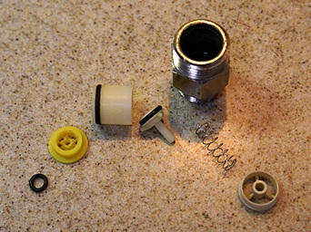 The disassembled kitchen faucet flow restrictor.