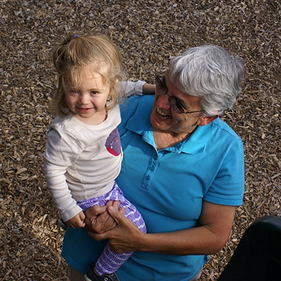 Madeline with Grandma Linda at the playscape by the Brighton Mill Pond.