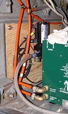 Fresh water pump on isolated plywood panel behind Oasis Combi.