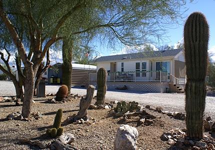 Joe & Connie's park model trailer as viewed through the cactus garden by our coach.