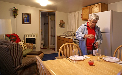 Linda starting to set the table in the apartment for Christmas dinner.  No pictures of Butch & Fonda (they are camera shy).