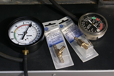 Pressure gauges and T-fittings for testing the Aqua-Hot fuel delivery.