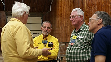 L-to-R: GLCC National Director Pat Lintner talks to newly elected President Bruce Fay and members Charles Martin and Ed Roelle.