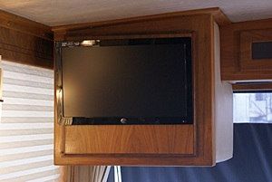 Front flat-panel TV/monitor with cabinet door closed.  Look ma, no wires!
