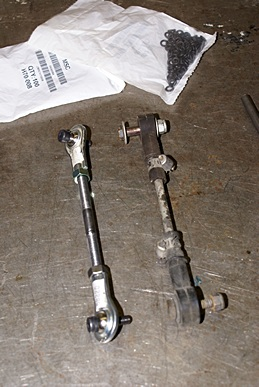 New ride height linkage (L) with ball ends.  Old linkage (R) with rubber ends.