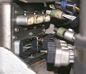 The DDEC II ECM on our DD8V92TA with all of the harnesses unplugged.