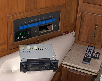 Bus bedroom driver side rear corner house systems control panel with Kenwood KRC 3004 radio removed.