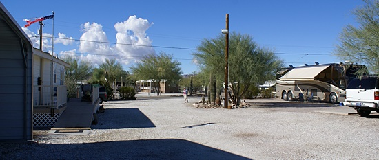 """The view to west (towards Lollipop Ln) from the east end of our """"camp.""""  Our coach is to the right with the awning out."""