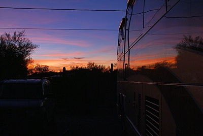 The last glow of this sunset reflects off the passenger side of our motorcoach in Quartzsite, AZ.