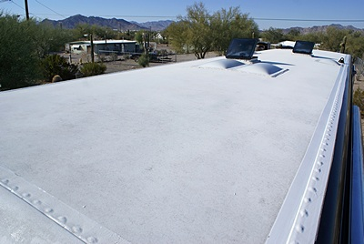 The roof of our bus after cleaning looking SW as viewed from the driver side front corner.  Quartzsite, AZ.