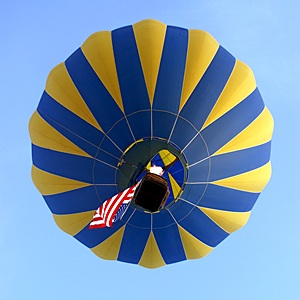 Lake Havasu City Balloon Festival kicks off with the National Anthem as the Flag goes airborn.