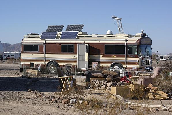 A classic older Bluebird Wanderlodge outfitted for serious desert boondocking.