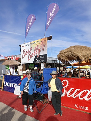 """Marilyn & Linda in front of Beer Belly's """"adult day care"""" outdoor bar."""
