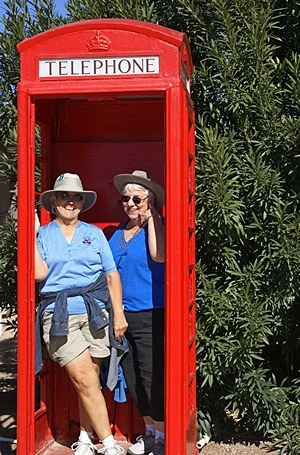 Linda& Marilyn at the London Bridge English village.  It's a real London phone booth, but no phone.