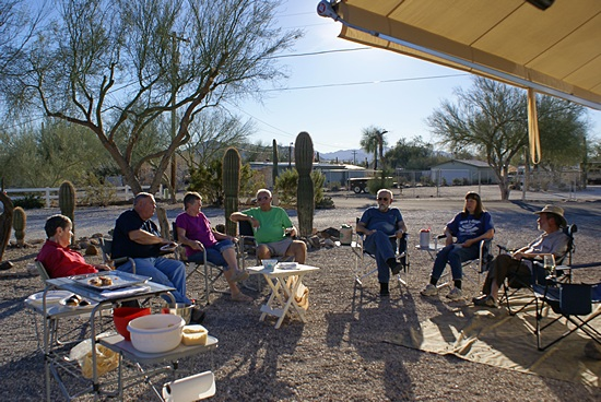 Our fellow campers gathered by our bus for my 63rd birthday happy hour.  L-2-R: Sandy, Larry, Barb, Jim, Butch, Fonda, me.   Photo by Linda (not shown).