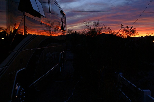 Another dramatic sunset reflected off the recently waxed driver's side of our coach.