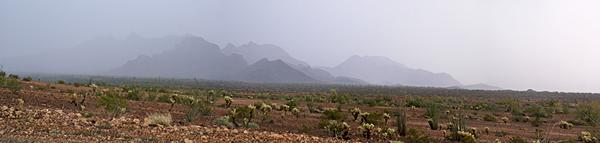 Heavy rain over the mountains and desert east of Quartzsite and south of Plomosa Road.