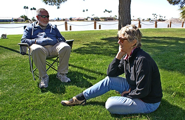 Forrest Clark and Marianne Edwards talking on the lawn at RVillage WHQ.