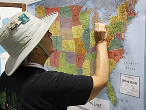 Linda puts a pin on the map to mark our home town.