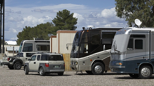 Our motorcoach, parked in an out-of-the-way place with Cathie & Bud Carrs motorhome, Travis & Melanie Carr's Airstream, and the Rivolli Review's motorhome.